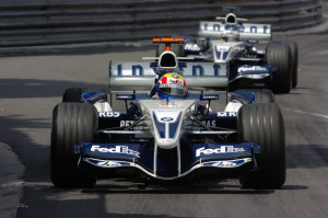 Mark Webber i Nick Heidfeld na putu prema dvostrukom pobjedničkom postolju za Williams, iza pobjednika Kimija Raikkonena u McLarenu. (22.5.2005.) Foto: Williams