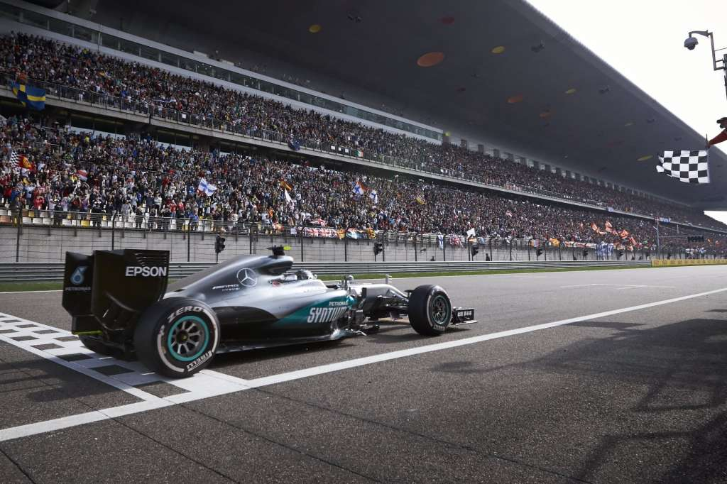 Nico Rosberg Mercedes W07 Hybrid China GP F1 2016 celebrates his 17th career victory crossing the finish line