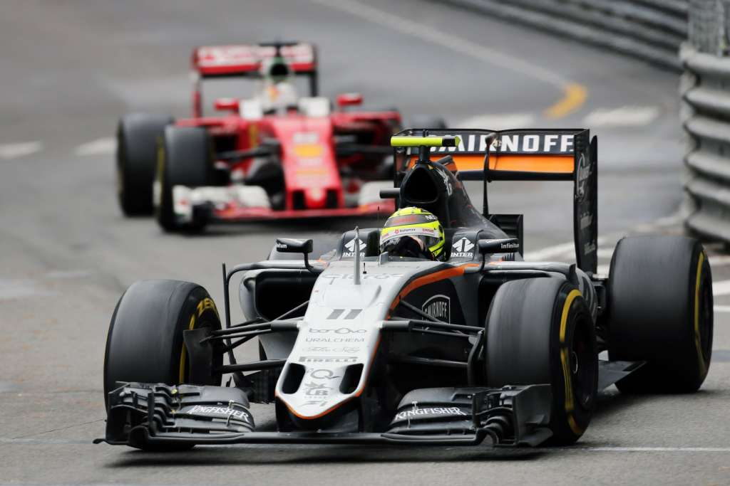 Sergio Perez Force India Mercedes VJM09 leads Sebastian Vettel Ferrari SF16-H Monaco GP F1 2016 Foto Force India