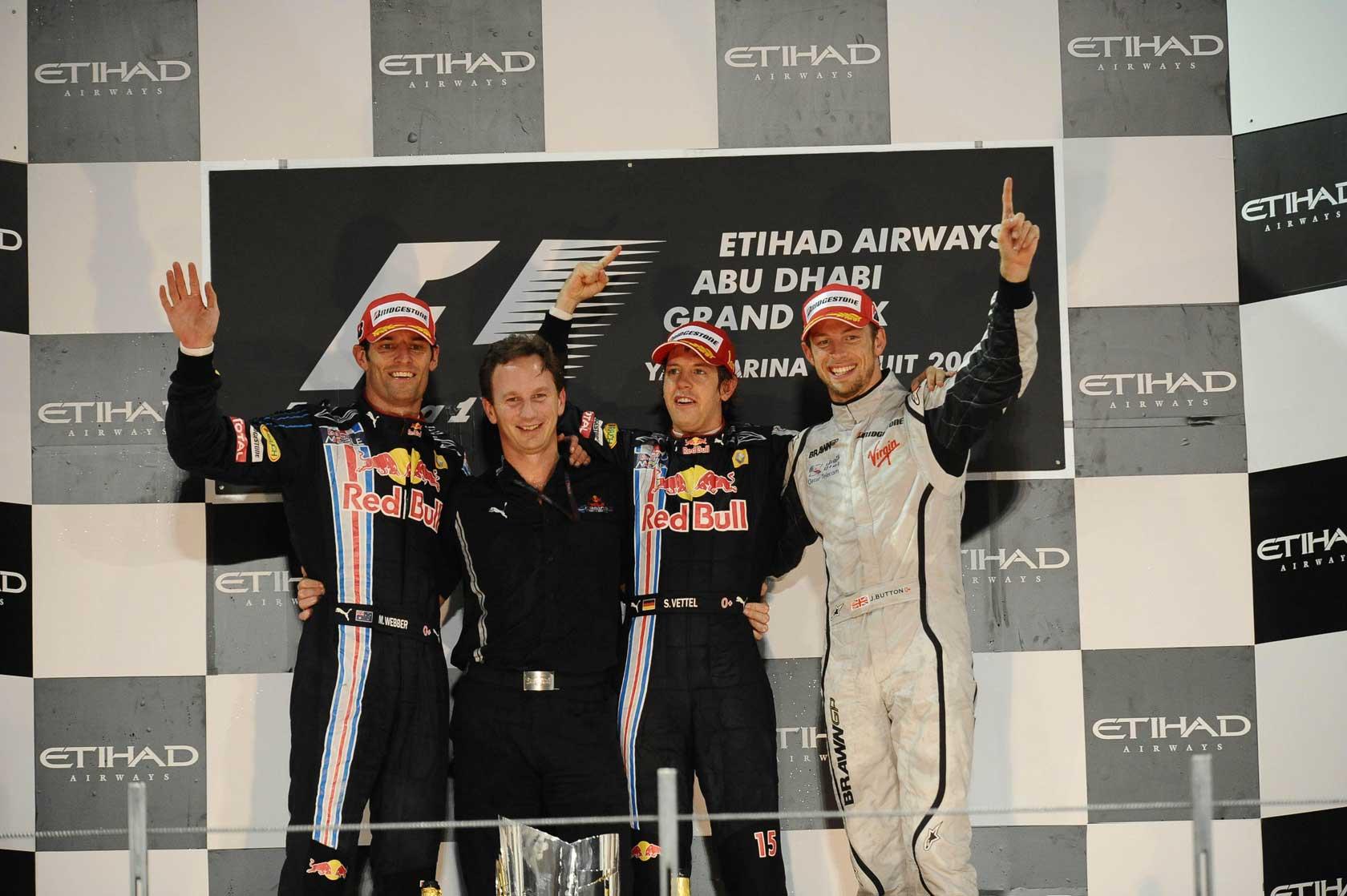 Pobjedničko postolje na prvoj VN Abu Dabija 2009. Slijeva nadesno: Mark Webber, Christian Horner, Sebastian Vettel i Jenson Button. (1.11.2009.) Foto: f1fanatic