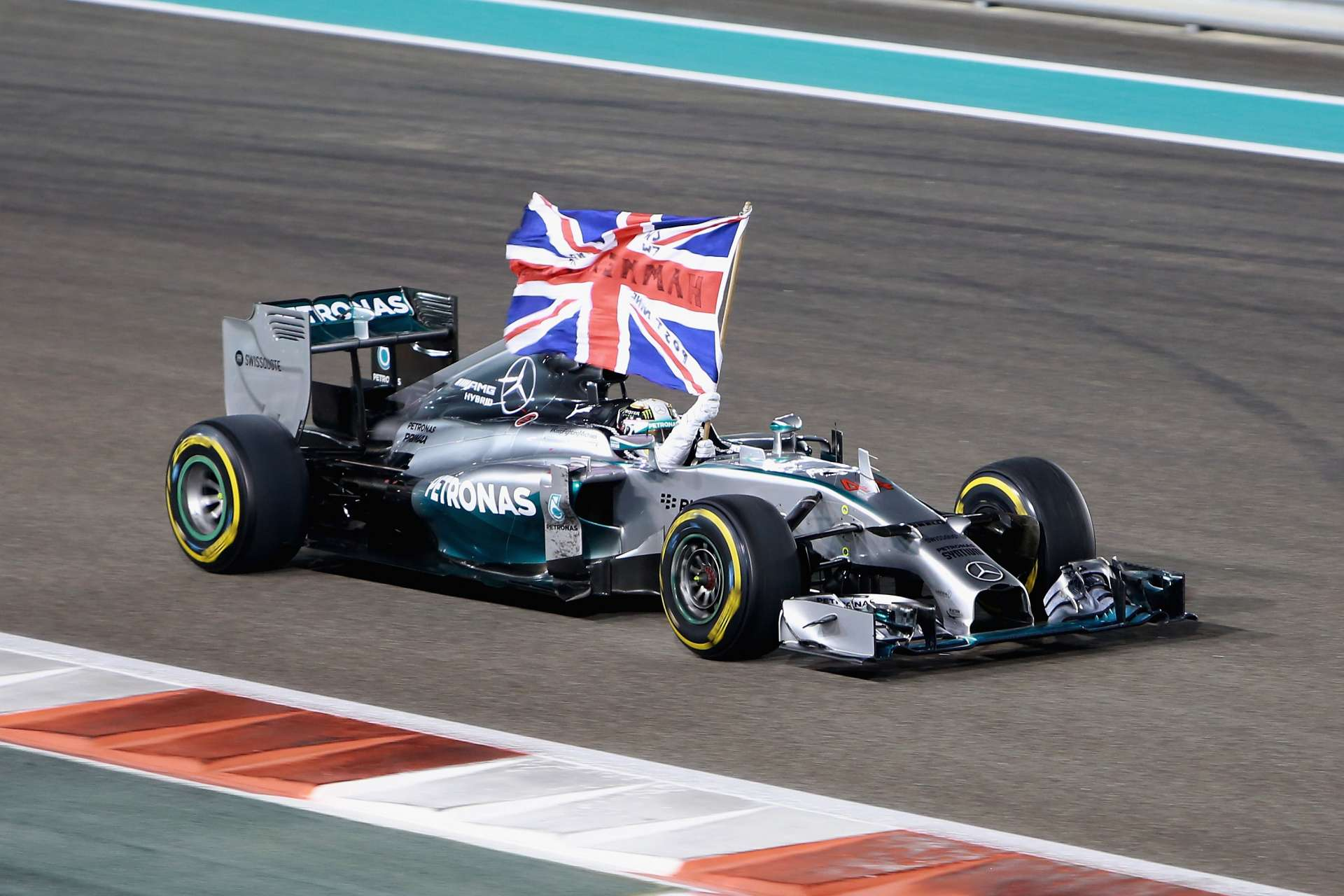 Lewis Hamilton slavi drugi naslov prvaka nakon pobjede na VN Abu Dabija 2014. (23.11.2014.) Foto: Getty
