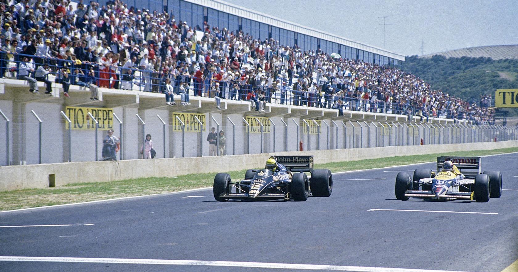 Ayrton Senna (Lotus) i Nigel Mansell (Williams) u borbi za pobjedu na VN Španjolske 1986., prvoj održanoj na stazi Jerez. Brazilac je slavio s prednošću od samo 14 tisućinki sekunde ispred Britanca. (13.4.1986.) Foto: Williams