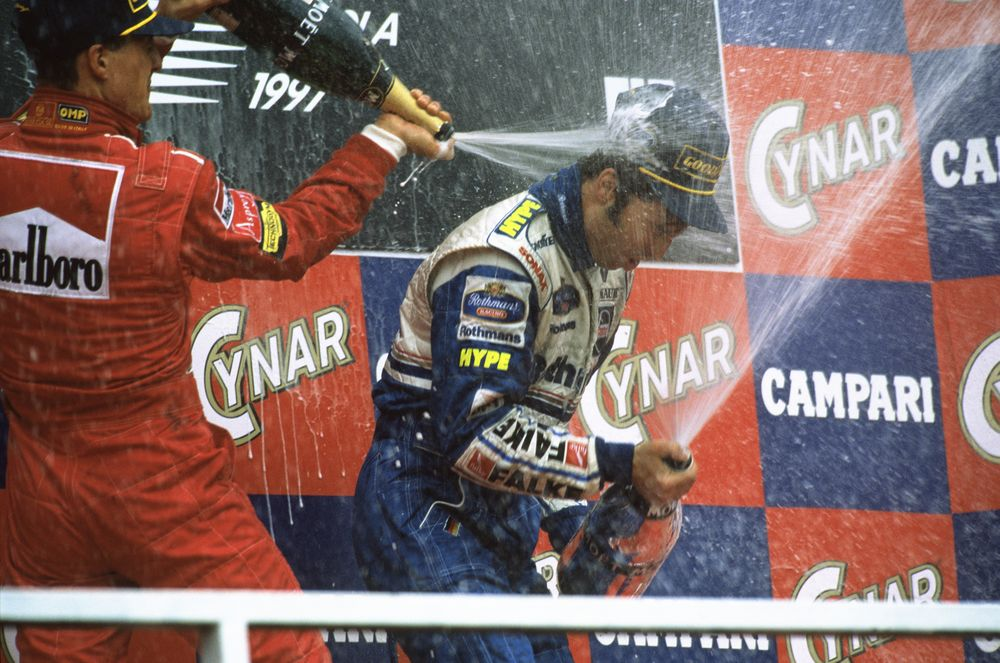 Heinz-Harald-Frentzen-Michael-Schumacher-and-Eddie-Irvine-San-Marino-GP-Imola-F1-1997-podium-ceremony-Foto-WIlliams