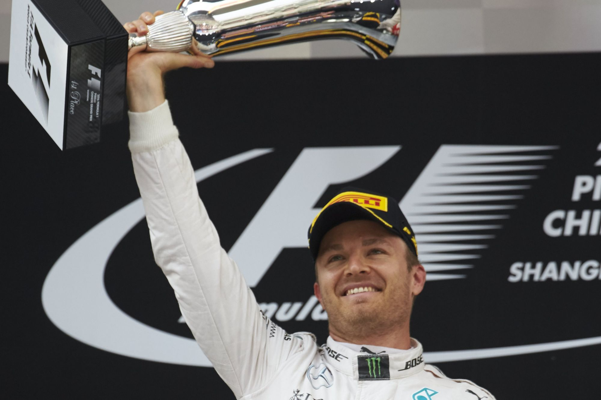 Nico Rosberg Mercedes W07 Hybrid China GP F1 2016 celebrates his 17th career victory at podium