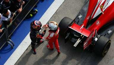 Sebastian Vettel and Daniil Kvyat shake hands after the Chinese GP F1 2016