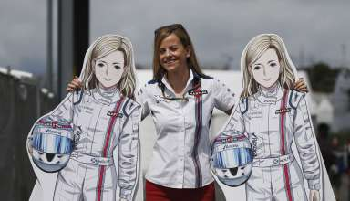 Susie Wolff Williams F1 team posing with cardboard figures