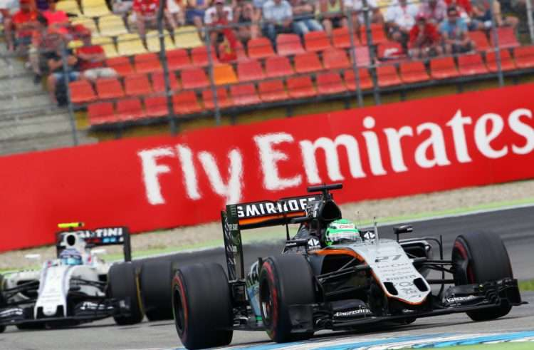 Nico Hulkenberg Force India VJM09 Mercedes leads Valtteri Bottas Williams Mercedes FW38 German GP F1 2016 Foto Force India
