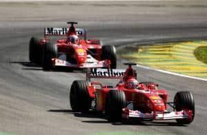 Michael Schumacher Ferrari F2002 leads Rubens Barrichello Ferrari F2001 Brazilian GP F1 2002 Foto Ferrari