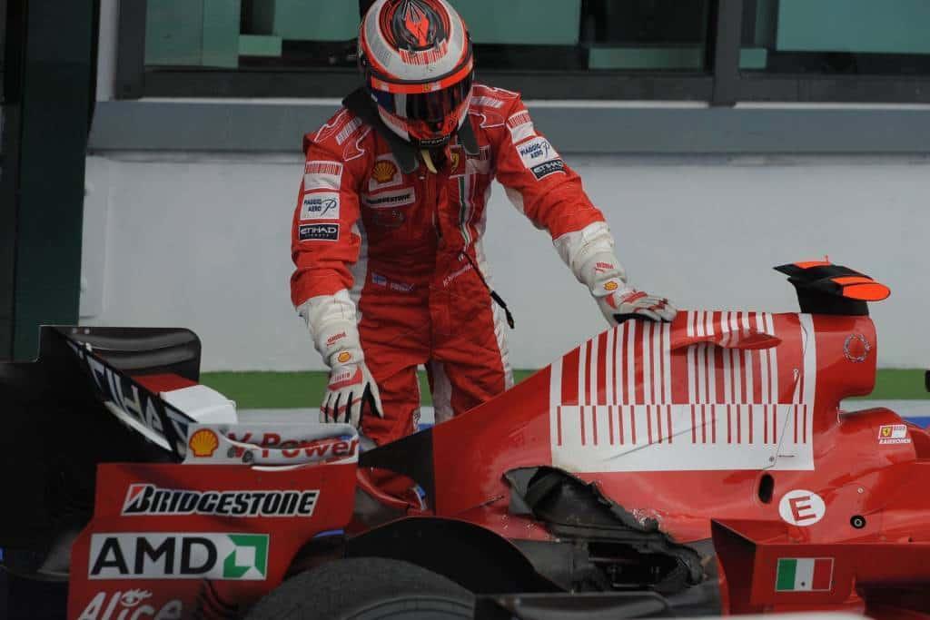 Kimi Raikkonen Ferrari F2008 French GP F1 2008 Magny Cours broken exhaust after the race parc ferme Photo Ferrari