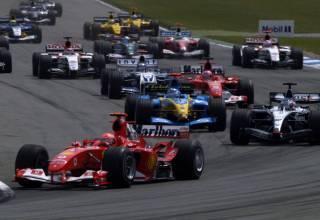German-GP-F1-2004-start-Schumacher-leads-1st-corner-Photo-Ferrari