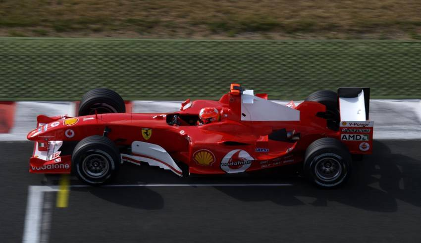 Michael-Schumacher-Ferrari-F2004-French-GP-F1-2004-side-Photo-Ferrari.