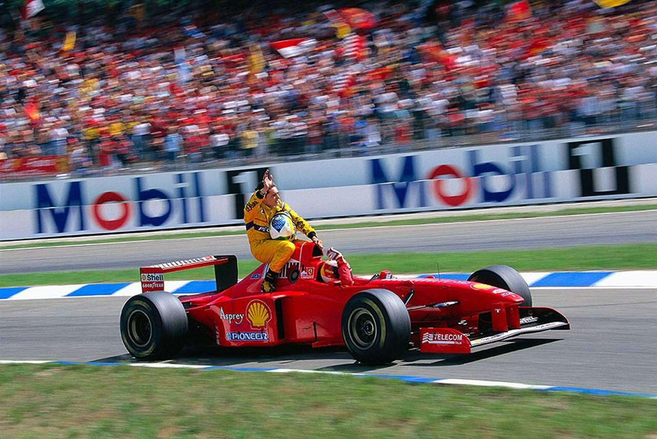 Michael-Schumacher-giving-Fisichella-a-ride-at-the-1997-German-Grand-Prix Photo Motorsport Retro