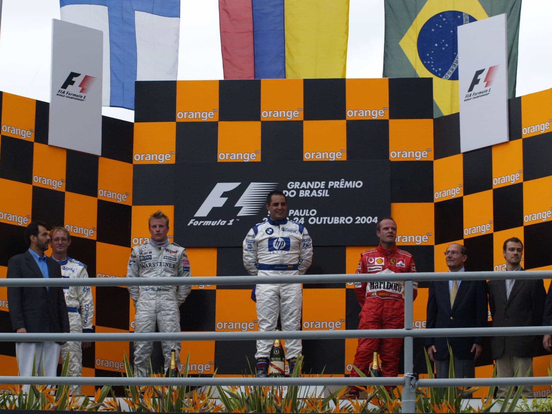 Brazilian-GP-F1-2004-podium-Montoya-Raikkonen-Barrichello-Photo-Ferrari