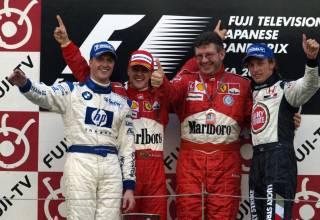Japanese-GP-F1-2004-podium-Photo-Ferrari.