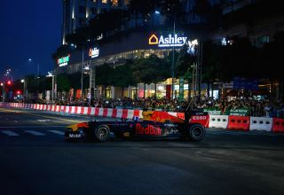 Coulthard Red Bull Aston Martin RB7 2018 Vietnam street demonstration side wide Photo Red Bull