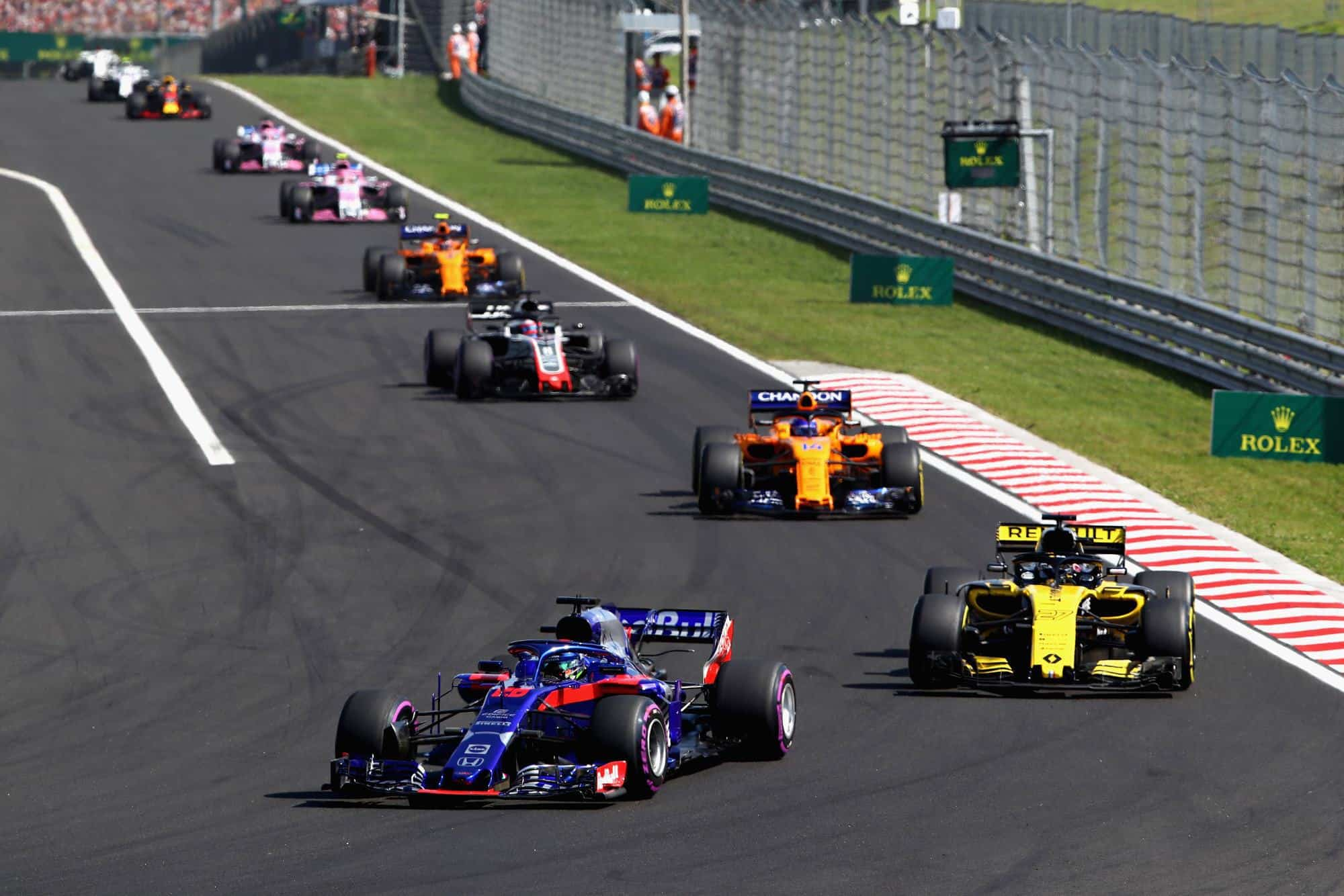 Gasly Toro Rosso leads Sainz Renault and Alonso McLaren Photo Toro Rosso Red Bull