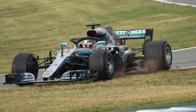 Lewis Hamilton Mercedes W09 German GP F1 2018 goes across the grass at the pitlane entry Photo Daimler F1