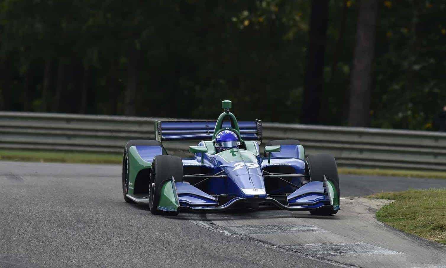 Alonso Indycar 2018 test Barber on the track on inside kerb Photo IndyCar