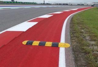 Austin F1 2018 new kerb Verstappen Raikkonen