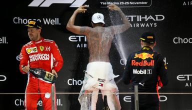 Hamilton Mercedes Abu Dhabi F1 2018 podium celebration naked back tatoo Still I Rise Photo Daimler
