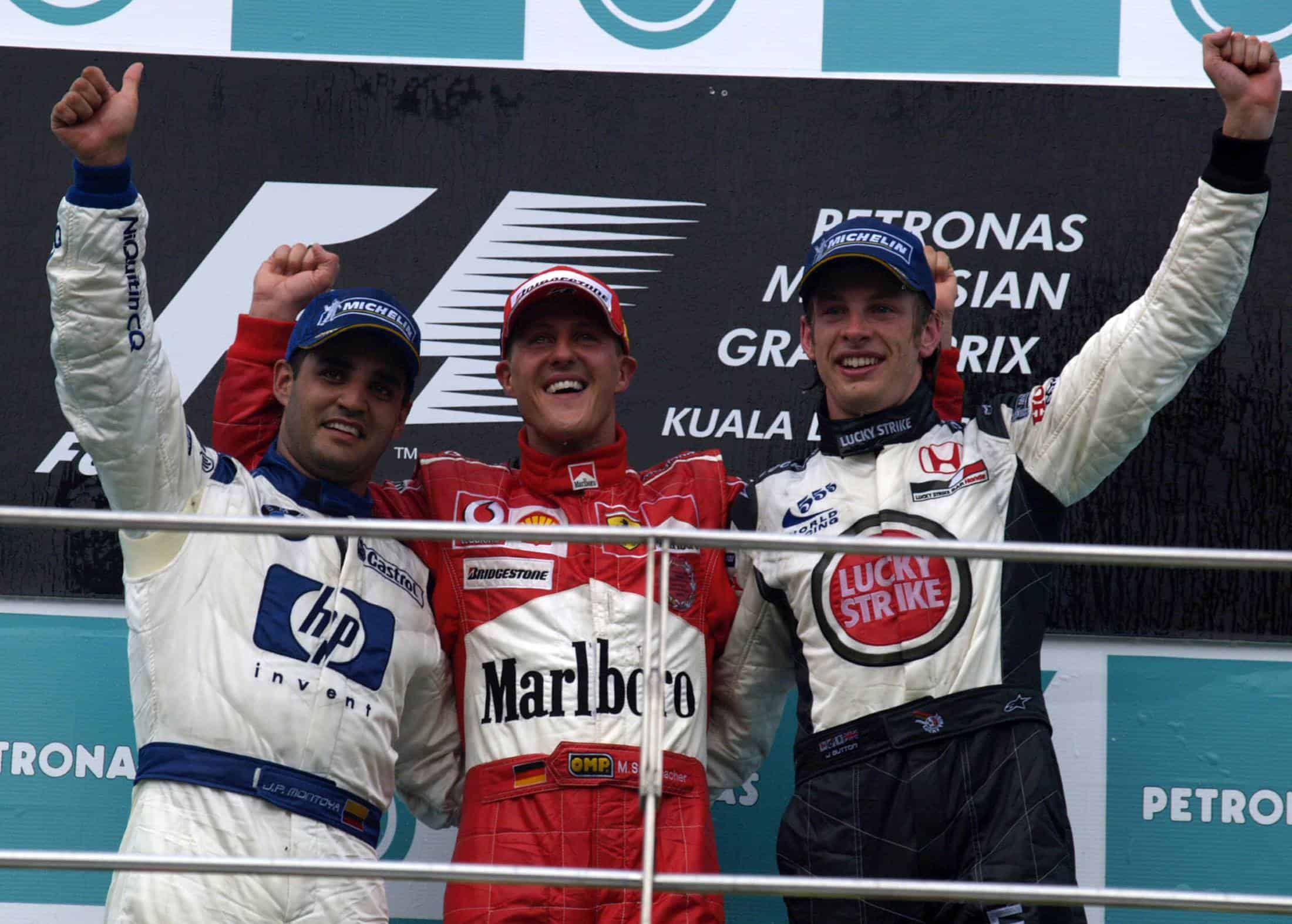 2004-Malaysian-GP-F1-podium-Michael-Schumacher-Montoya-Button-Photo-Ferrari