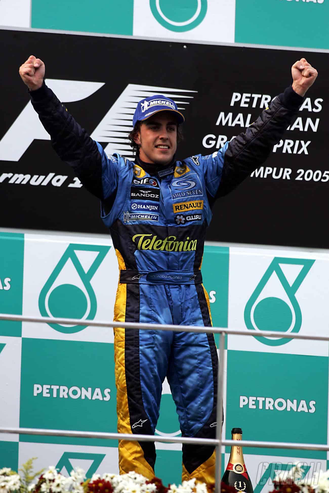 2005 Malaysian GP F1 Fernando Alonso celebrate on the podium Photo Chrash-net