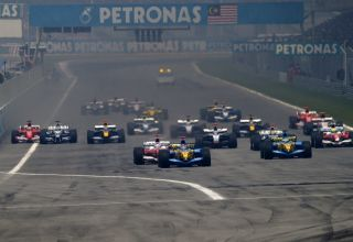 2005-Malaysian-GP-F1-start-Fernando-Alonso-leads-Jarno-Trulli-Photo-Ferrari