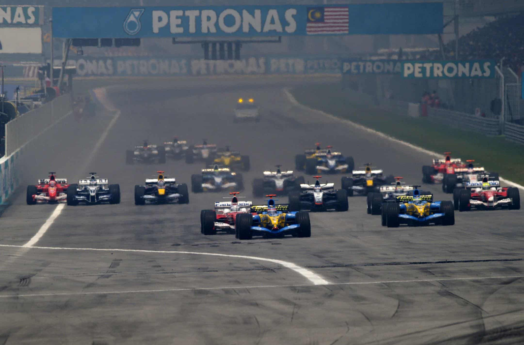 2005-Malaysian-GP-F1-start-Fernando-Alonso-leads-Jarno-Trulli-Photo-Ferrari