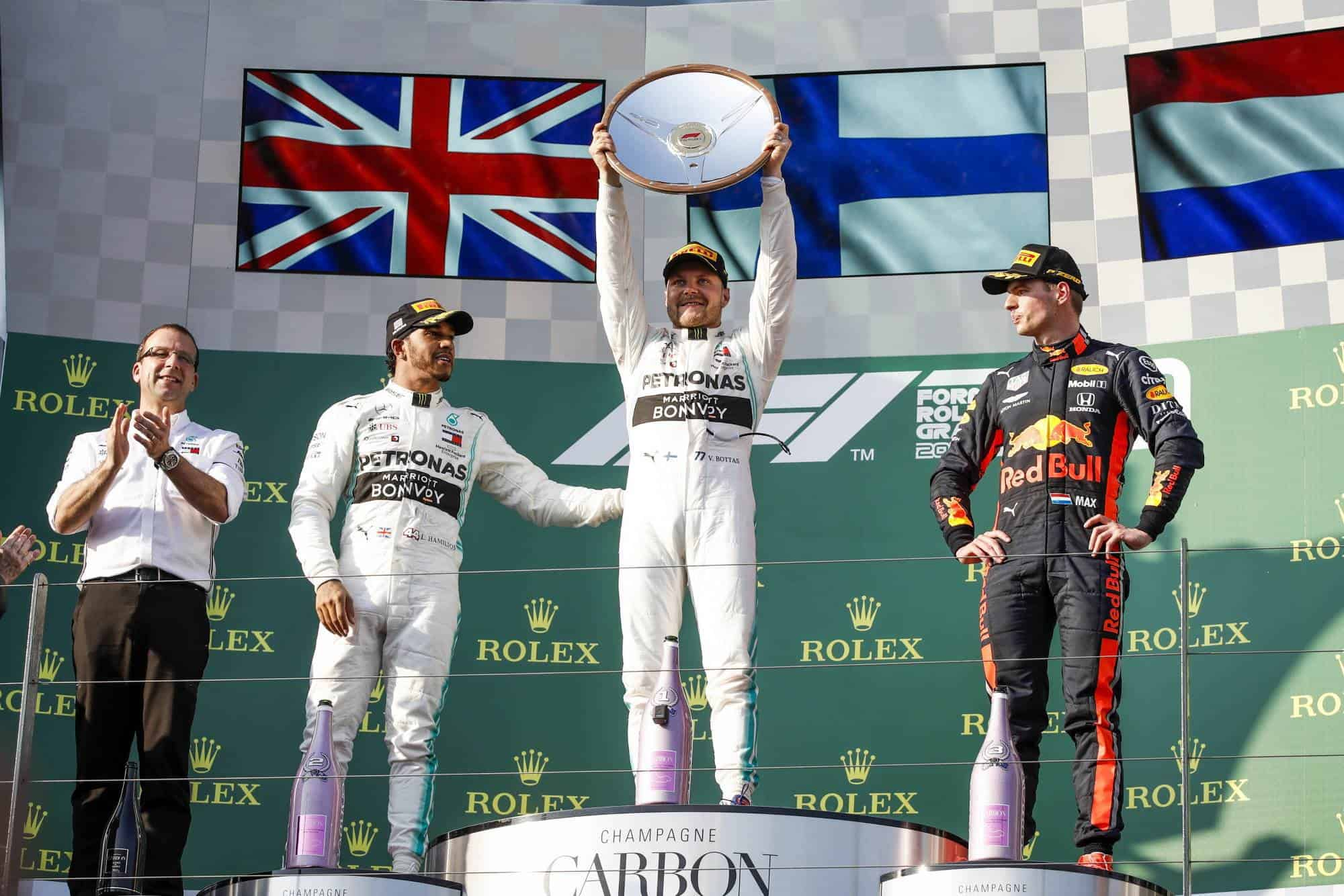 Australian GP F1 2019 podium Bottas Hamilton Verstappen Photo Daimler Edited by MAXF1net
