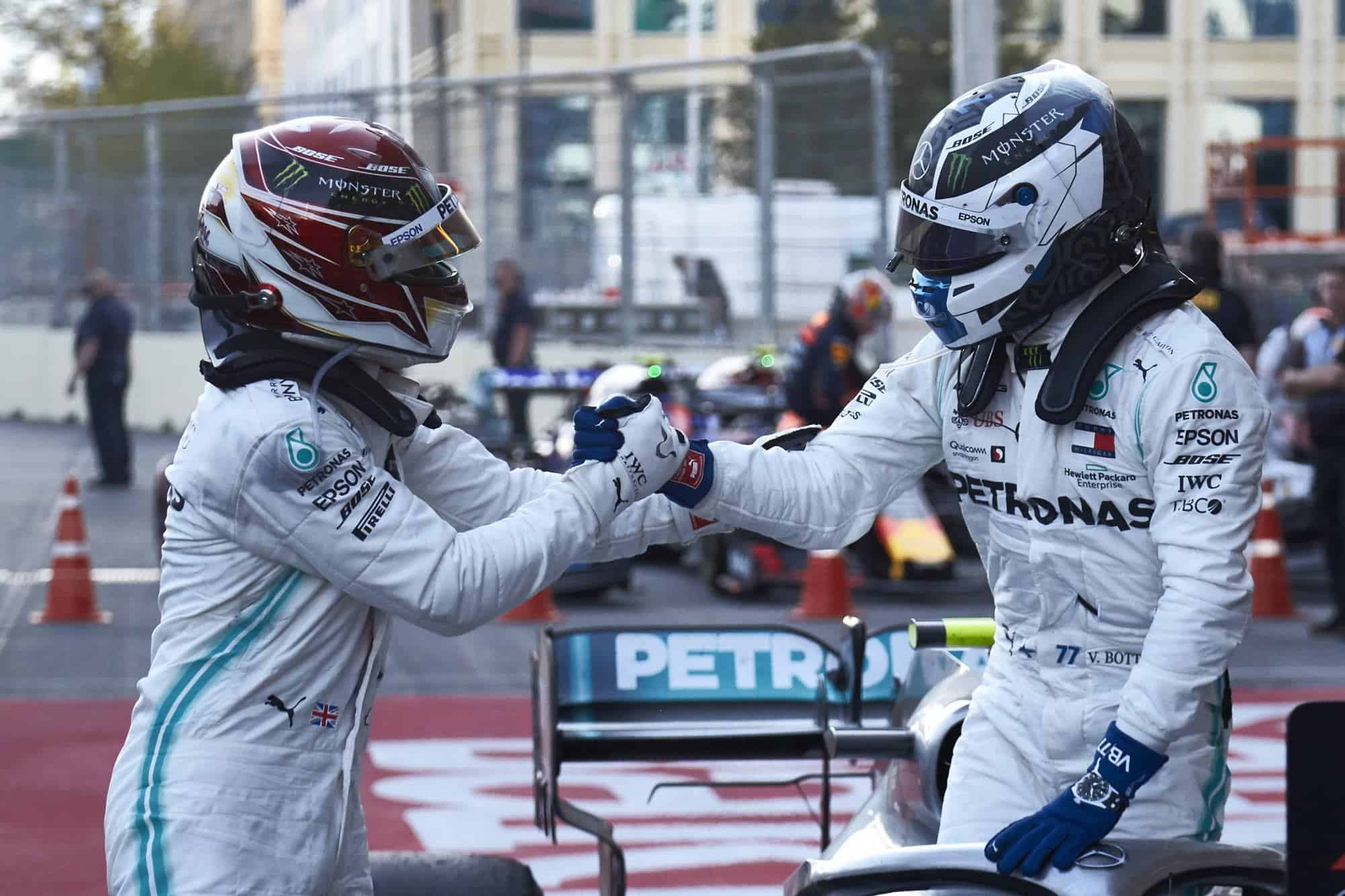 Azerbaijan GP F1 2019 Bottas and Hamilton after the race with helmets Photo Daimler