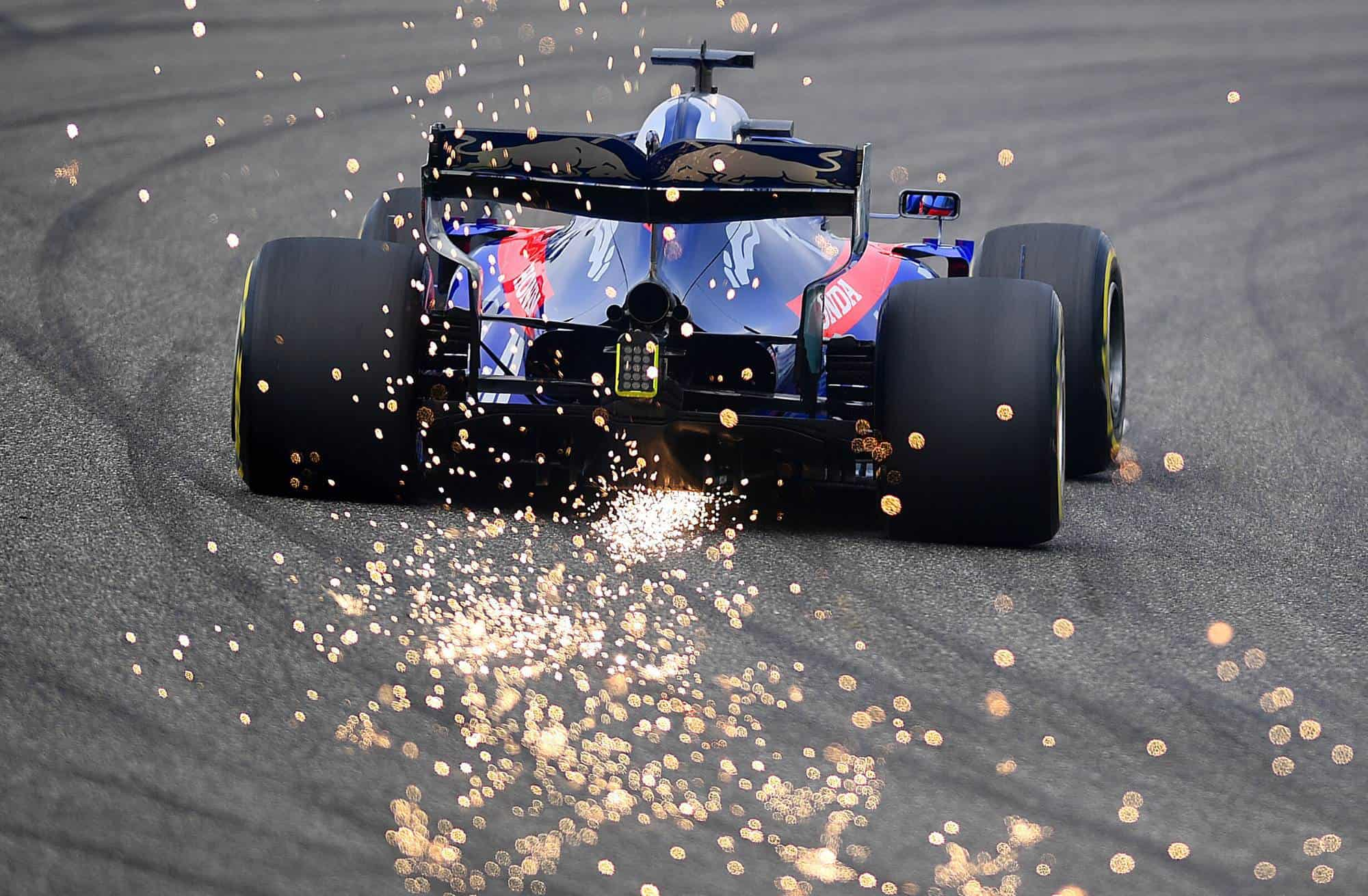 Daniil Kvyat Toro Rosso Honda STR14 Chinese GP F1 2019 rear end first corner sparks Photo Red Bull