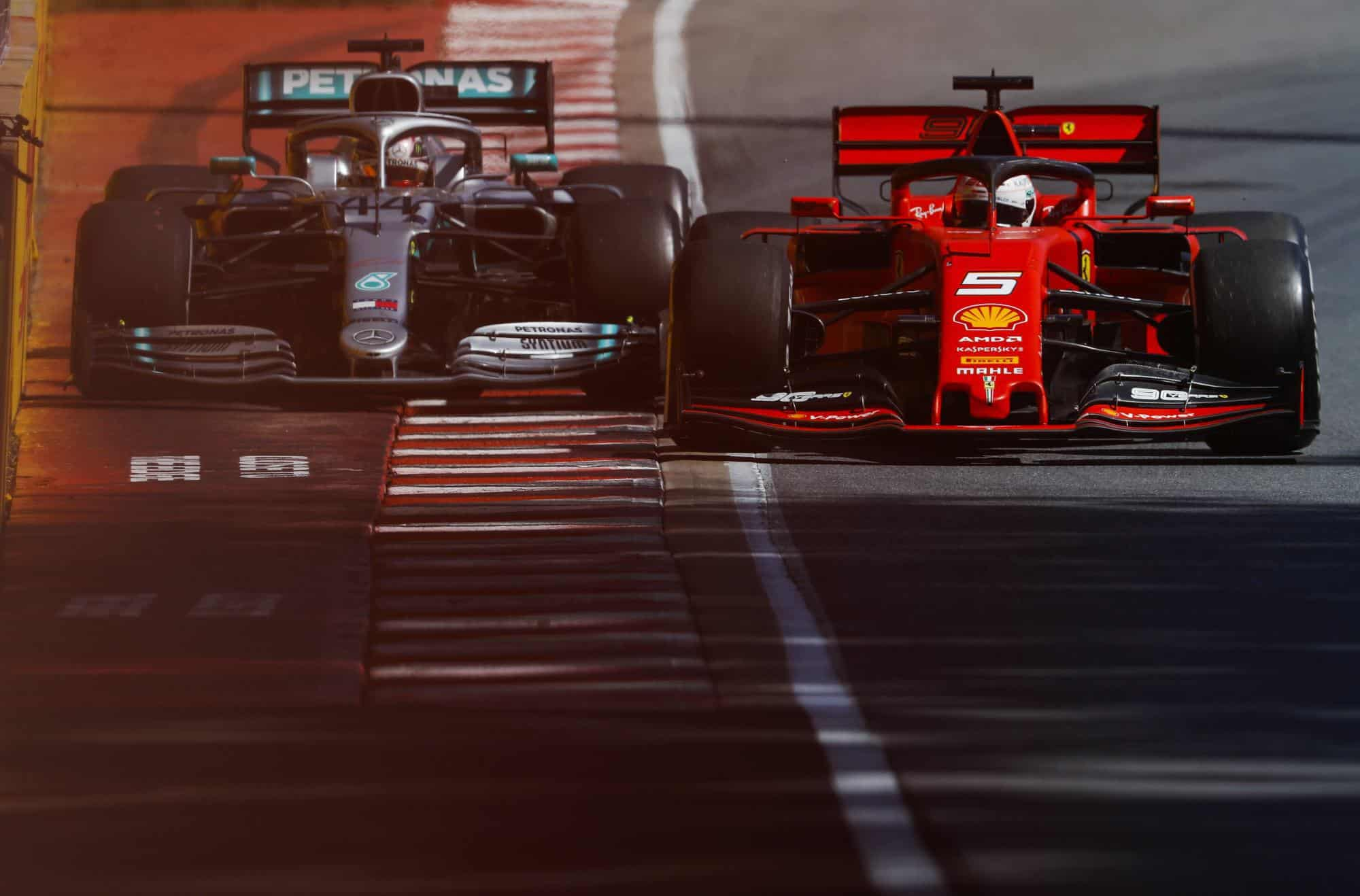 Lewis Hamilton Mercedes F1 W10 and Sebastian Vettel Ferrari SF90 Canadian GP F1 2019 celebrating victory Photo Daimler