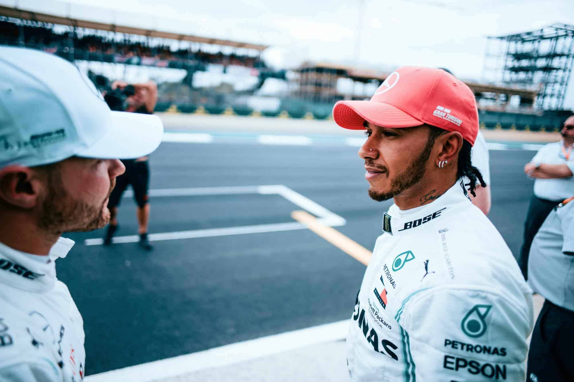Bottas and Hamilton Mercedes British GP F1 2019 post qualifying on track out of cars Photo Daimler
