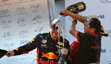 Toyoharu Tanabe and Max Verstappen celebrate Honda's first victory in hybrid era Austrian GP F1 2019 podium Photo Red Bull