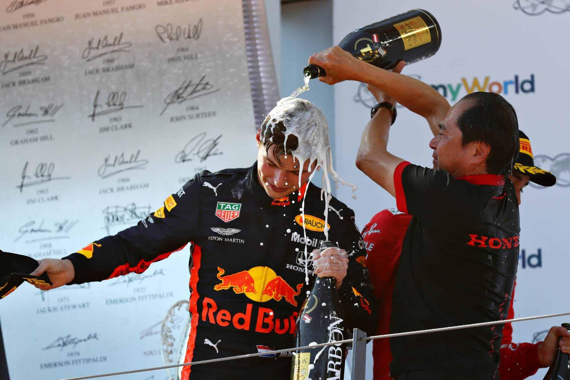 Toyoharu Tanabe and Max Verstappen celebrate Honda's first victory in hybrid era Austrian GP F1 2019 podium Photo Red Bull