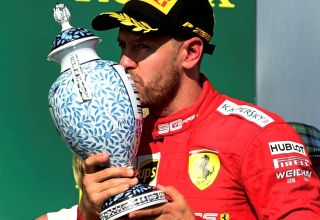 Sebastian Vettel Ferrari Hungarian GP F1 2019 on the podium with trophy Photo Ferrari