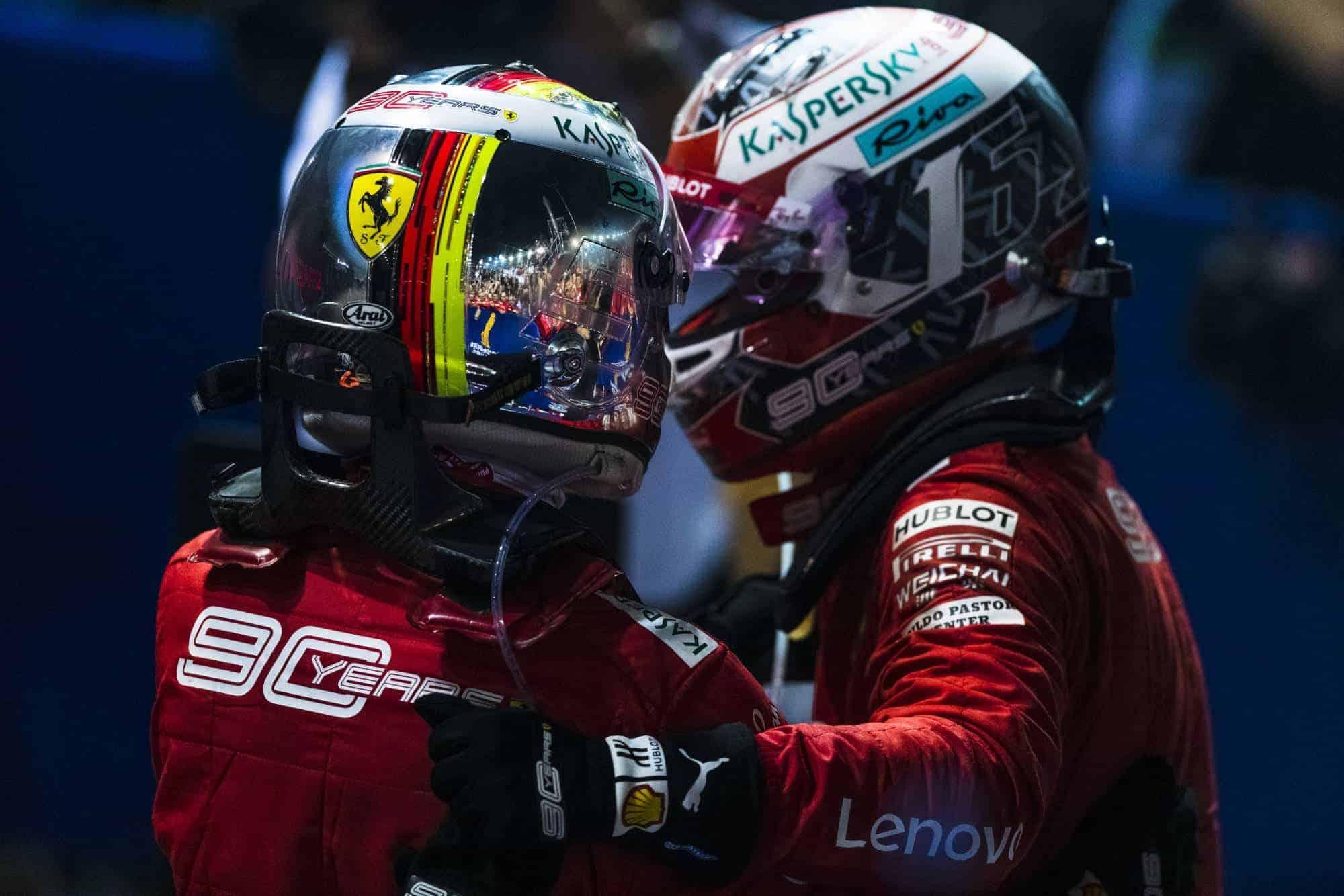Charles Leclerc and Sebastian Vettel Ferrari SF90 Singapore GP F1 2019 after Race celebrating 1-2 Photo Ferrari
