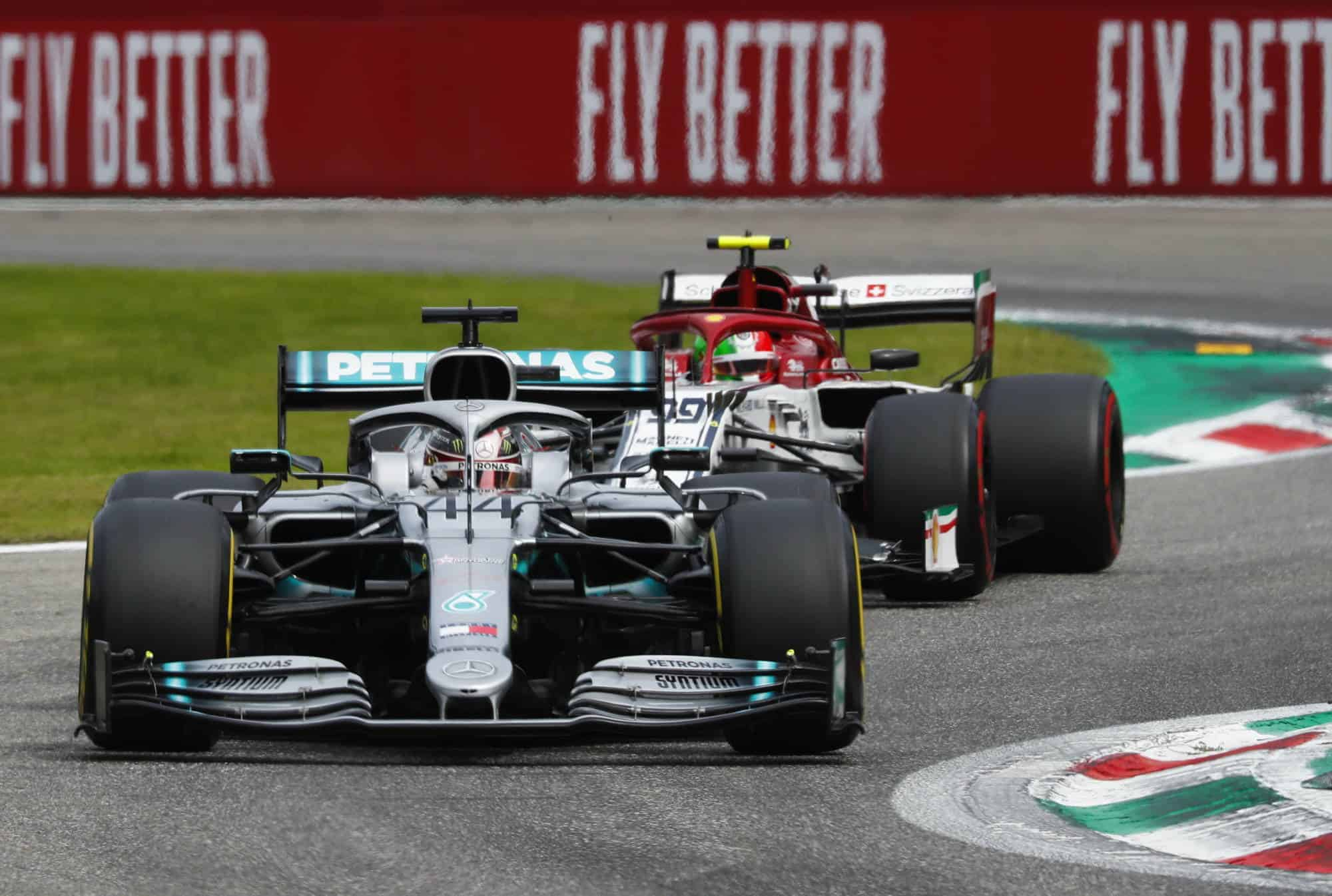 Lewis Hamilton Mercedes F1 W10 Italian GP F1 2019 Monza Ascari chicane with Antonio Giovinazzi Alfa Romeo C38 Photo Daimler