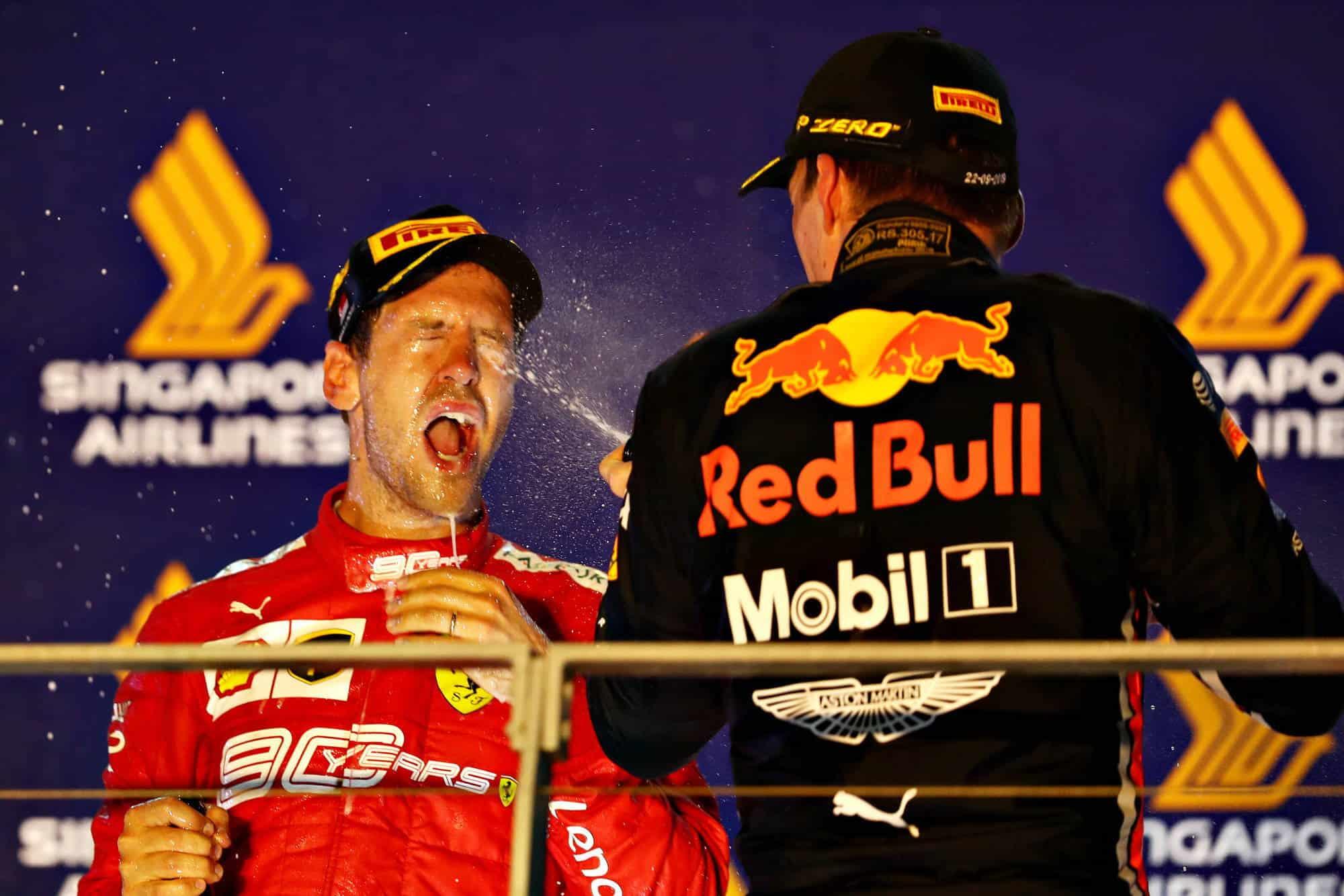 Vettel and Verstappen Singapore GP F1 2019 champagne on the podium Photo Red Bull