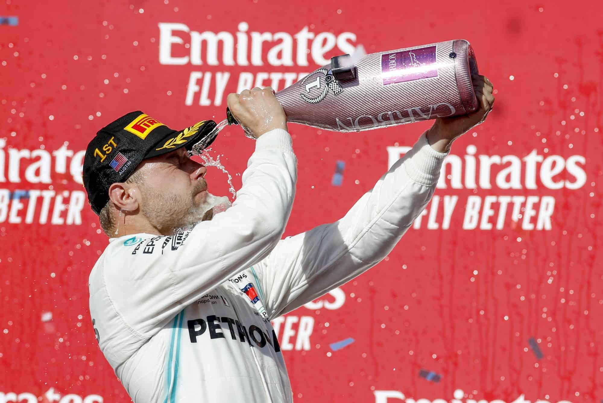 Bottas Mercedes USA GP F1 2019 Austin on the podium champagne Photo Daimler