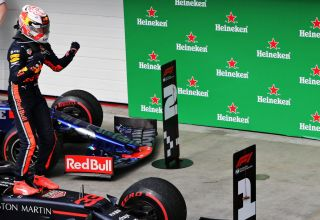 Verstappen celebrates 2019 Brazilian GP victory F1 2019 parc ferme on the car Photo Red Bull