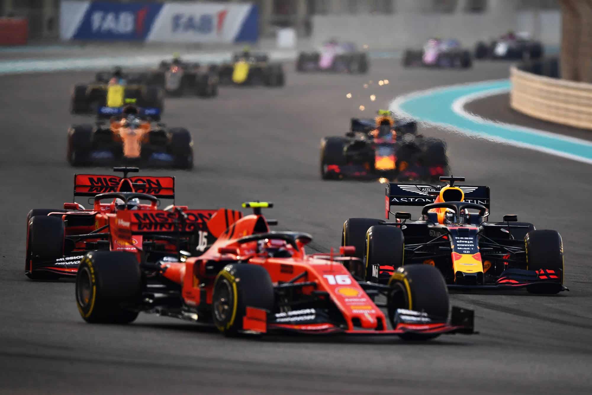 2019 Abu Dhabi GP Verstappen battling Leclerc and Vettel Photo Red Bull