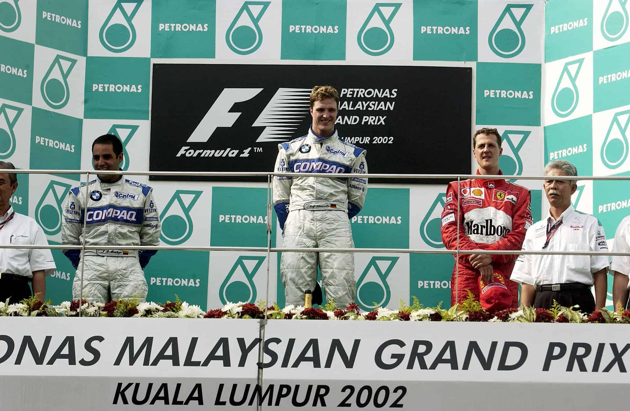 2002 Malaysian GP podium Ralf Schumacher Juan Pablo Montoya Michael Schumacher Photo Ferrari