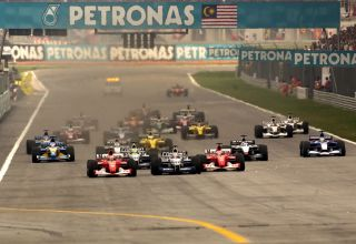 2002 Malaysian GP start Schumacher Montoya Photo Ferrari