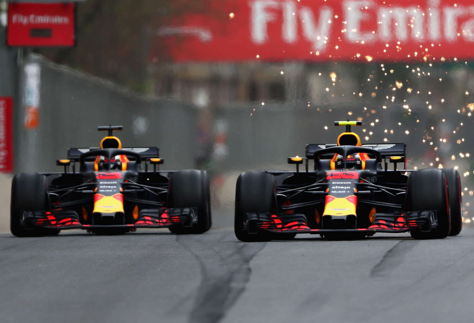 2018 Azerbaijan GP Ricciardo and Verstappen battle Photo Red Bull