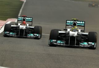 Nico Rosberg and Michael Schumacher 2012 Chinese GP Mercedes F1 W03 Photo Daimler Edited by MAXF1net