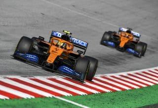 Lando Norris, McLaren MCL35, leads Carlos Sainz, McLaren MCL35