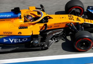 Carlos Sainz, McLaren MCL35, in the pit lane