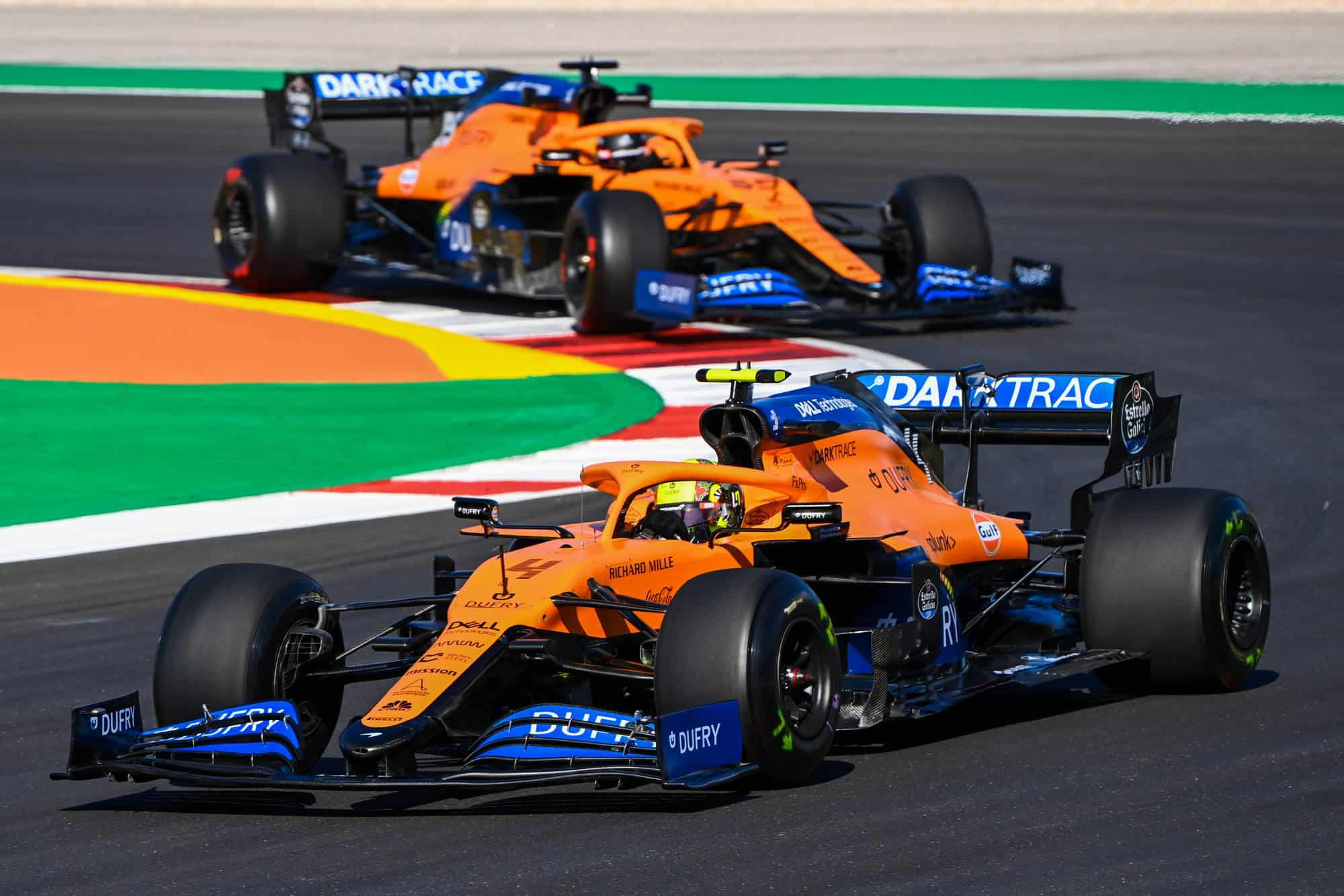 Lando Norris, McLaren MCL35 leads Carlos Sainz, McLaren MCL35