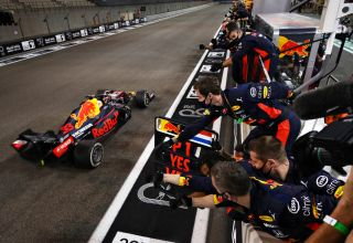 2020 Abu Dhabi GP Verstappen wins crosses the finish line Photo Red Bull